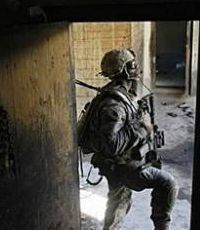 Расмуссен хочет добавить солдат в Афганистан