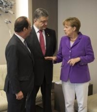 Меркель: трехсторонняя контактная группа должна продолжить работу в действующем формате