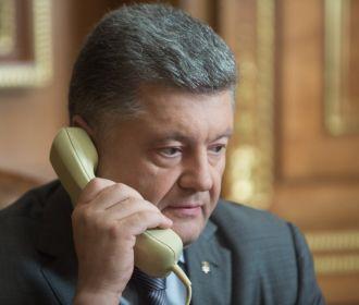 Порошенко и Меркель решили, что Сенцова нужно немедленно освободить