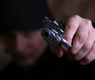 Вооруженные иностранцы ограбили киевлянина на 600 тыс. грн