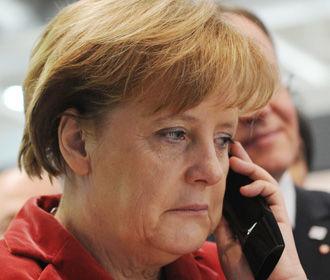 Меркель надеется, что Путин не будет направлять войска в Беларусь